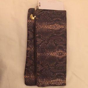 Brown snakeskin fold over clutch/ Clare Vivier